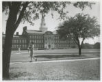 Girl walking and Fondren Science Building