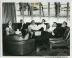 Lambda Chi Alpha fraternity members relaxing in living room