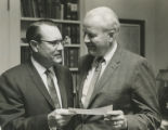 George M. Underwood presenting a check to SMU President Willis M. Tate