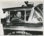 Bob Hope chauffeured in police car