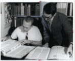 Decherd Turner and Page Thomas look at Bibles