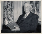 Hiram Boaz posing with his book Eighty Four Golden Years