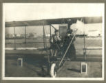 [Man and Older Woman on Biplane]
