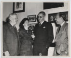 [Everette DeGolyer, Sr. standing with Phyllis Cerf, Bennett Cerf and an unidentified man]