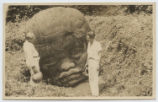 [Everette DeGolyer, Sr. standing with an unidentified man by a Cabezon, one of four colossal Olmec...