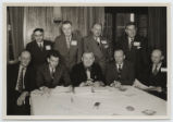 [Everette DeGolyer, Sr. sitting with men from the Interstate Oil Compact Commission]