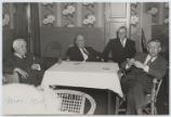 [Everette DeGolyer, Sr. sitting with E.E. Pyle, Robert Minckler, president of the General...