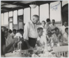 [Everette DeGolyer, Sr. sitting a table with Senator Antonio J. Bermudez and Congressman Charles...