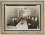 [Everette DeGolyer, Sr. sitting at a dinner table with nine other men]