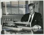 [Everett DeGolyer, Jr. with Model Train]