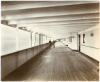 [First class promenade deck, looking aft]