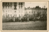 [German officers on horseback at the head of a crowd of people in Kiev]
