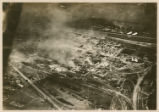 [Aerial view of a burning munitions factory]