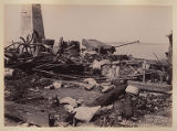 View of northeast corner of room O, showing ground bared by force of explosion, and remains of...