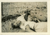 [Horton and Lillian Foote Laying on the Beach]