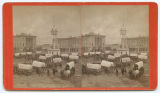 [Unidentified Texas plaza with tower and courthouse in background]