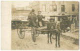 [Two unidentified men in a cart, San Antonio, Texas]
