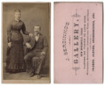 [Couple, man seated and woman standing]