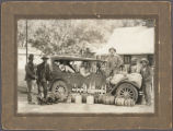 [Border Patrol officers with bootlegger stash near Shafter, Texas]