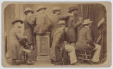 [Seven men, Louis de Planque (photographer) standing, second from right]