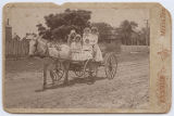 [Carriage with five women]