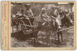 [Wagon pulled by donkeys with girl and boy riding donkeys, McKinney, Texas]
