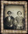 [Older Texas couple with plaid homespun cloth border]