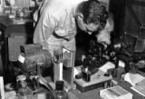 Melvin Shaffer with microscopic camera, Medical Museum and Arts Service