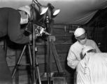 Melvin Shaffer filming in the OR, 8th Evacuation Hospital, Italy, 1944
