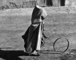 Small boy and the hoop game, Bou Saada, Algeria, 1943