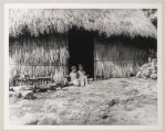 [Sergio and Patsy Sitting in Entrance of First Medellin Home in Piste, Yucatan]