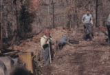 Workman working in drain, Daingerfield, Tex., 1970