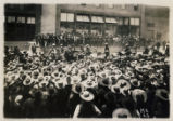 [Colonel William C. Greene with arm outstreched addressing a crowd of Mexican workers during...