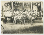 [Large Group Portrait of Men and Women, Some with Bicycles]