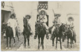 [Five Mexican youths on horseback, three with rifles]