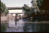 [Canoes approaching bridge on Trinity River]