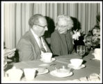 Photograph of Rabbi Levi A. Olan and Kate Warnick seated during a luncheon on February 9, 1972 as...