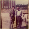 Photograph of Decherd Turner and Levi A. Olan in front of the ground breaking for the expansion of...