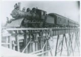 [Copper Range, Locomotive 52 on railroad bridge]