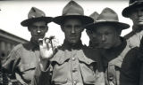 [Close-up of troopers holding cracker.]