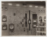 [Checking gauges on circuit board, Continental Oil Co.]