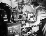 Woman at Heald machine, Engineering Laboratories Inc., Tulsa