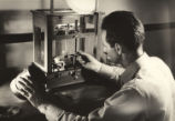 [Technician Testing Carbon Sample, Continental Carbon Co.]