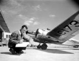 [Man with Map next to Lockheed 12A Electra Junior, Delta Air Lines]