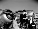 [Station Agent and Two Models in front of Lockheed 10B Electra, Delta Air Lines]
