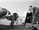 [Refueling Aircraft with Neoprene Hose, E.I. du Pont de Nemours and Company]