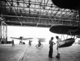 [Floatplanes, Sailors Riding Bicycles in Hangar at Naval Air Station Corpus Christi, Bethlehem...