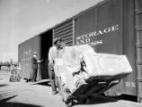 [Worker Transporting Packages, Texas & Pacific Railway Company]