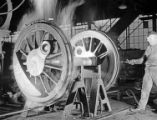 [Machinist Checking Temperature of Locomotive Wheel, Texas & Pacific Railway Company]