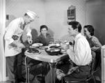 [Actors at Table, Motion Picture Kitchen Set, Texas-Illinois Co.]